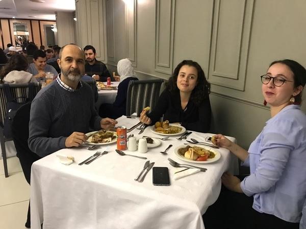 EC staff enjoying their meals at the Iftar dinner