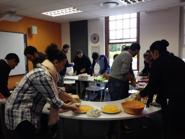 EC Cape Town students preparing sandwiches to hand out to the children of Kalkfontein